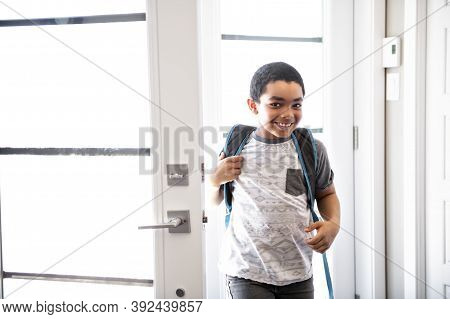 A Child Boy Coming Home Passing Through The Door After School