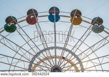 Vintage Ferris Wheel Over Sky. Park Amusement With Huge Ferris Wheel