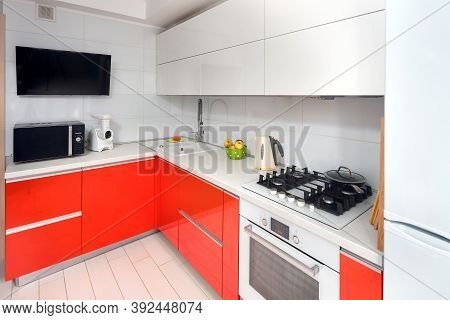 Upscale Maple Red And Smoky White Kitchen In Luxury Home With Stoneware Counter Top Flat Wooden Pane