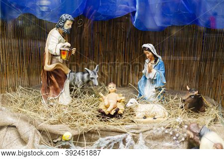 Nativity Scene, Holy Family Figurines On Hay. Birth Of Savior Jesus Christ, Christmas Essence