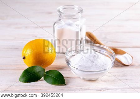 Eco-friendly Natural Cleaners. Vinegar, Baking Soda, Salt And Lemon On Wooden Table. Homemade Green