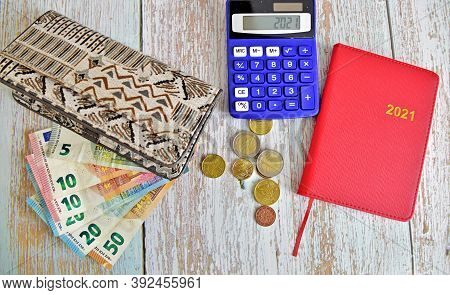 Wallet And Money, Euro Bills And Cents, Notebook Calendar And Calculator