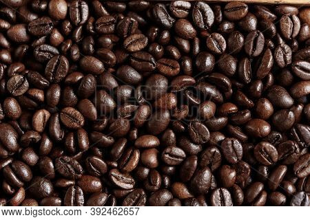 Closeup Of Perfect Roasted Coffee Beans Background. Food Ingredients, Top View, Space For Text. Soft