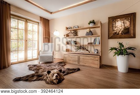 Part Of The Living Room With The Balcony Doors Bathed In The Rays Of The Summer Sun. The Interior Is