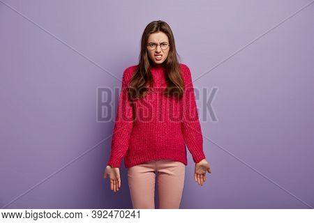 Fed Up Woman With Dissatisfied Expression, Frowns And Smirks Face, Feels Pissed Off, Wears Optical E