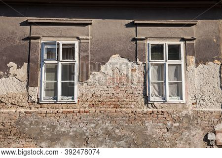 Old Windows With White Curtain On The Residential Building Of A Farm In Vojvodina, Serbia, With A Da