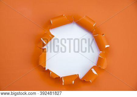 Hole In The Paper Or Through Paper Ripped Hole Advertising With Breakthrough And Design Space For Te