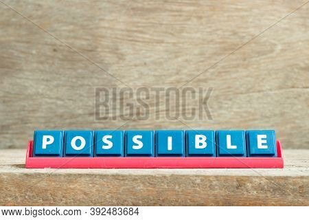 Tile Letter On Red Rack In Word Possible On Wood Background