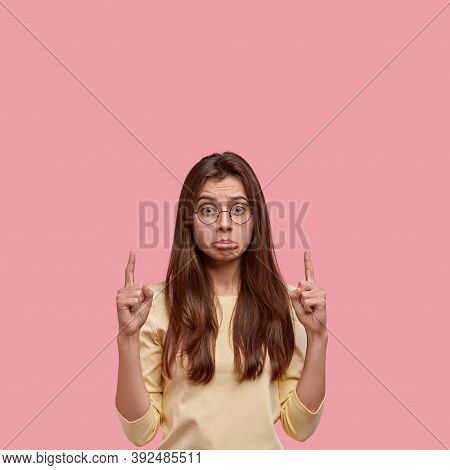 Dejected Dissatisfied Woman Has Sorrowful Expression, Frowns From Dislike, Has Pleasant Appearance,