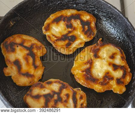 Burnt Pancakes In A Frying Pan. A Serving Of Homemade Refried Tortillas. Top View At An Angle. Selec