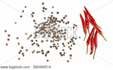Balck Pepper And Red Chili Peppers Isolated On White Background.