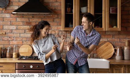 Banner View Of Overjoyed Couple Renters Have Fun At Home