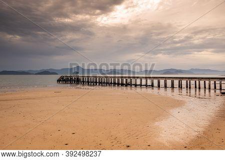Sunrise Or Sunset On The Sea Coast With Pier Near Sea Water