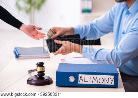 Young couple divorcing in alimony concept