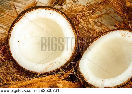 Two Halves Of Coconut With Coconut Fiber. Close-up