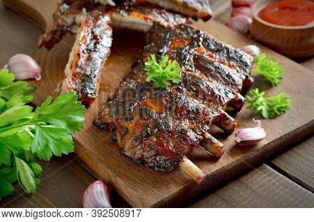 Spicy Hot Grilled Spare Ribs On Cutting Board. Tasty Bbq Meat
