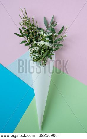 Top View Closeup Of Beautiful Bouquet Of Delicate Small White Flowers With Green Leaves In Paus Trac
