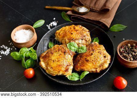 Fried Chicken Thighs In Plate On Dark Stone Background