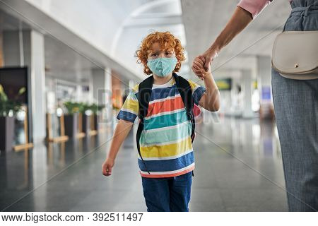 Upset Kid With Backpack Holding A Hand
