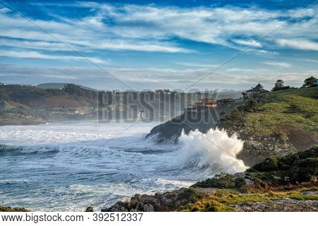 Huge Waves Crashing Onto The Shores Of Cabo De Ajo On The Northern Spanish Coast