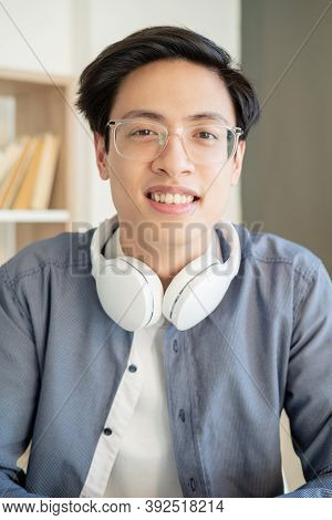 Ambitious Asian Guy. Student Lifestyle. Distance Learning. Online Education. Portrait Of Cheerful Sm