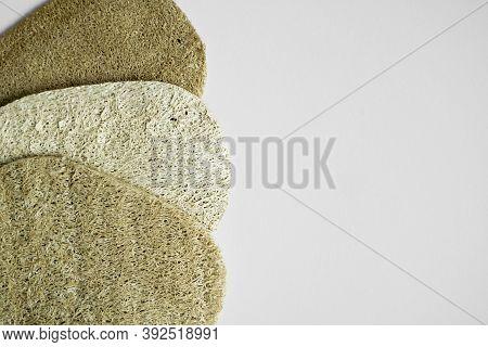 Natural Loofah Kitchen Dish Washing Sponges. Eco Friendly Dishwashing Sponge On A Gray Surface, Top