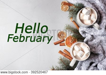 Hello February Greeting Card. Flat Lay Composition With Aromatic Hot Winter Cocoa On Light Table
