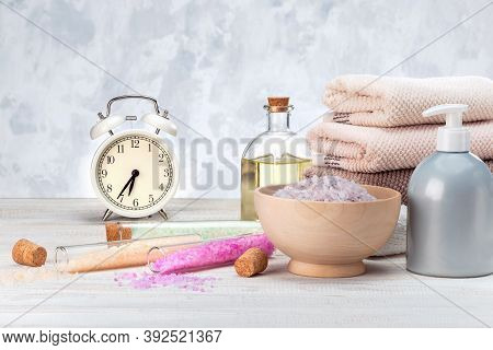 Concept, Time To Prepare For Spa. Beautiful Spa Composition With Alarm Clock And Natural Cosmetics P