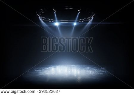 Winter Background. Spotlight Shines On The Rink. Bright Lighting With Spotlights. Beautiful Empty Wi