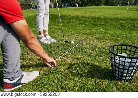 Young Caucasian Woman Taking A Golf Lesson