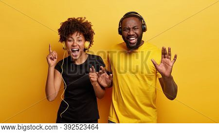 Young Fellows Have Boosting Mood, Sing And Dance Together, Find Cool Tracks For Disco Party, Wears B