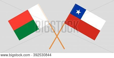 Crossed Flags Of Madagascar And Chile. Official Colors. Correct Proportion. Vector Illustration
