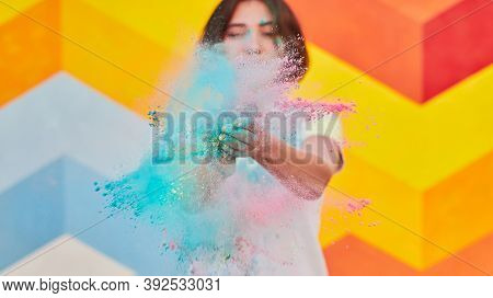 Young Female Clapping Hands And Throwing Bright Dry Pigment At Camera While Having Fun At Festival A