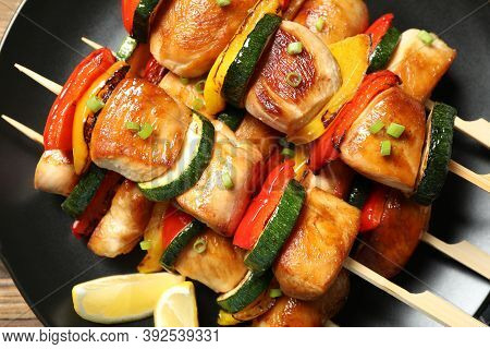 Delicious Chicken Shish Kebabs With Vegetables And Lemon On Plate, Top View