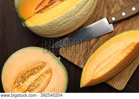 Tasty Fresh Melons On Wooden Table, Flat Lay