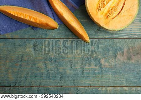 Tasty Fresh Cut Melon On Light Blue Wooden Table, Flat Lay. Space For Text