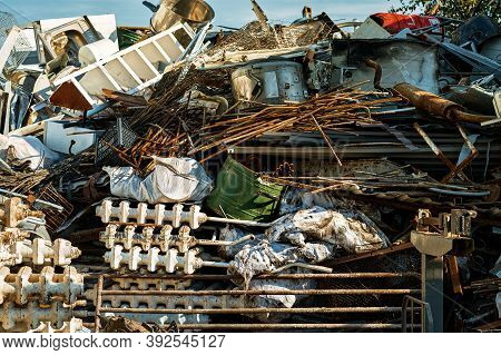 Storage Of Scrap Metal. Piles Of Scrap Metal For Recycling In An Open-air Warehouse. Collection Of R