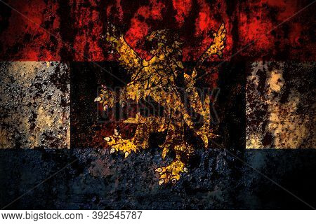 Benelux Flag On Grunge Metal Background Texture With Scratches And Cracks