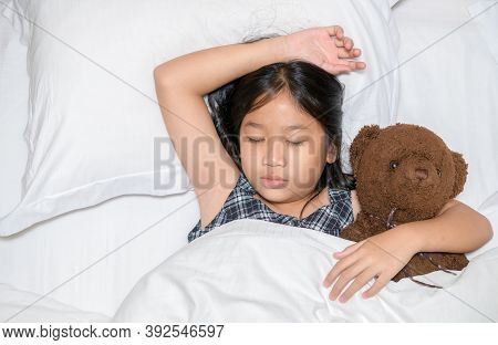Cute Little Girl Hugging Teddy Bear Sleeping Lay In  Bed, Happy Small Child Embracing Toy Fall Aslee