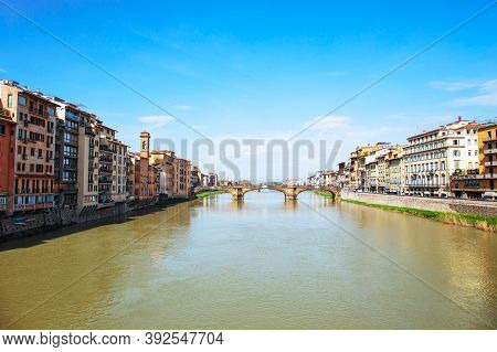 View Of Arno River With St. Trinity Bridge In Florence, Italy