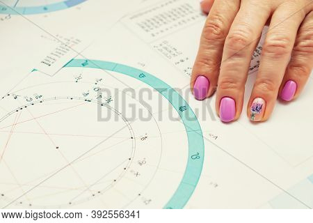 Workplace Of A Modern Astrologer. Printouts Of Astrological Charts, Charts, Tables, Diagrams Lying O