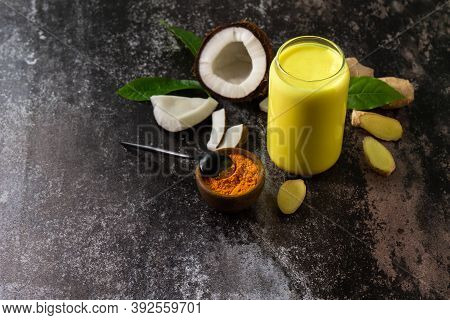 Healthy Ayurvedic Drink Golden Coconut Milk With Curcuma Powder Ginger On A Stone Countertop. Copy S