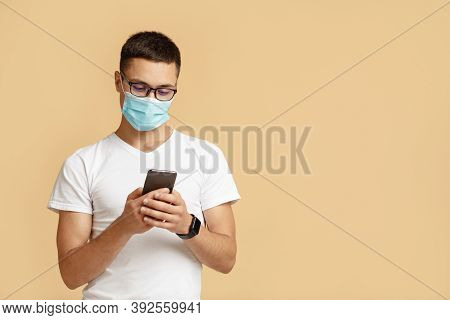 New Normal, Self-isolation And Social Media During Covid-19 Epidemic. Millennial Man In Protective M