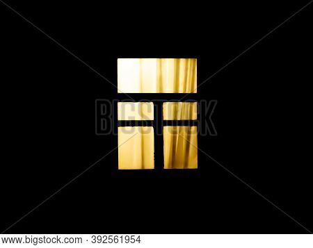The Window Of The House Glows In The Dark At Night. Electric Light At Night In The Window Of The Hou
