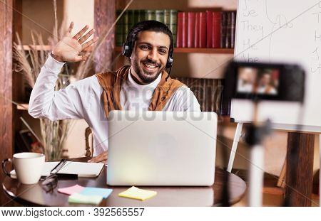 Indian Teacher Man At Laptop Teaching English Online Making Video Lesson For His Educational Blog Si