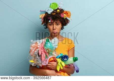 Fatigue Afro American Woman Participates In Cleaning Earth Campaign, Looks With Miserable Facial Exp