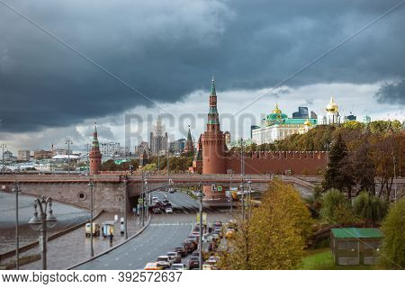 View Of The Kremlins Part In And The Great Zamoskvoretsky Bridge With Traffic From Cars In Cloudy We