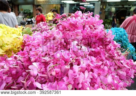 In Selective A Large Pile Of Purple Thai Orchid Flowers Selling In A Flower Market In Thailand With