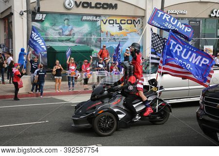 Huntington Beach, CA / USA - October 31, 2020: Re-elect President Donald J. Trump MAGA-Ween Costume Rally. Thousands of people gathered together at the Huntington Beach Pier to Rally for Donald Trump.