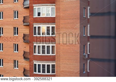 Comfortable New Highrise Apartment Building Made Of Red Bricks With Elegant Terraces And Glass Windo